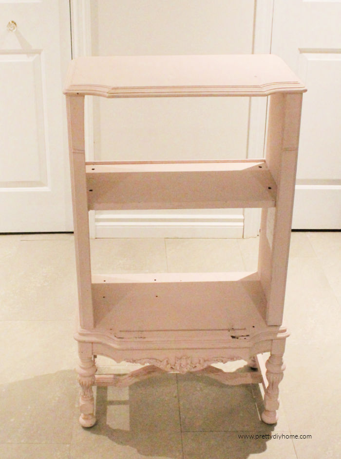 The before picture of a blush chalk painted antique cabinet