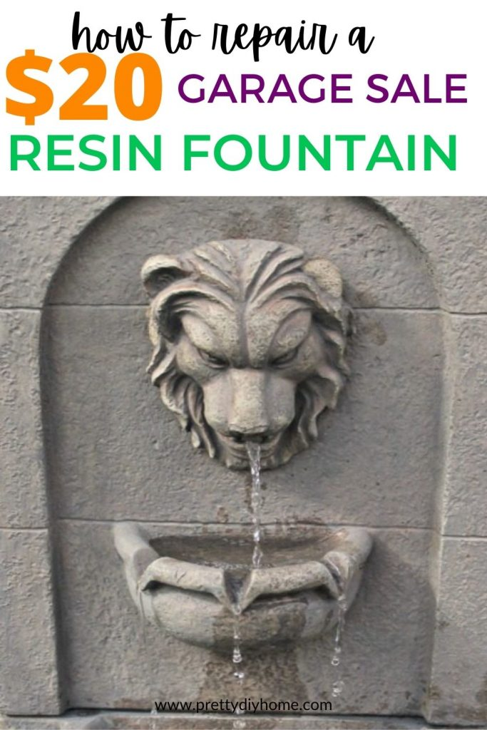 A repaired outdoor fountain with a lion head spout with cascading water droplets down into a basin filled with succulents.
