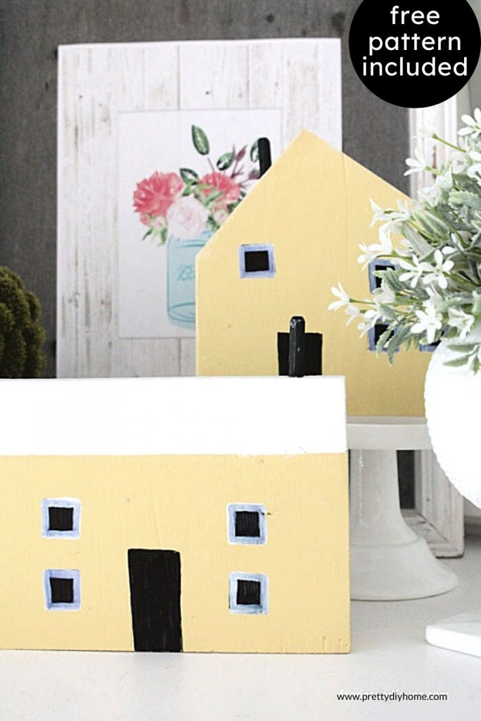 Two DIY wood houses for decor made out of scrap wood and painted with a soft yellow latex paint. Pretty, and soft farmhouse decor that makes me think of an English cottage garden vignette.