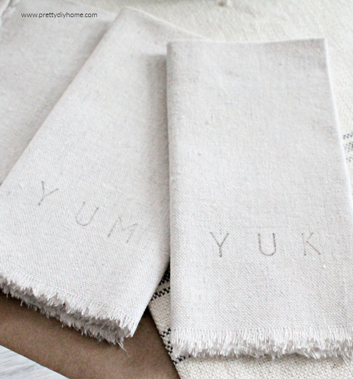 Fringed Fabric No Sew Fabric Napkins, made with duck cloth or drop cloth and hand stamped with Yum or Yuk wording.