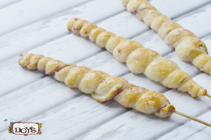 Twirls of cinnamon bread twisted onto sticks for a camping dessert recipe for families.