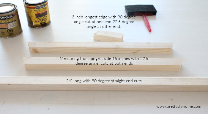 Wood lumber cut in different lengths for making a hanging frame for farmhouse wall art.