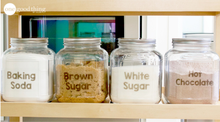 Four large pantry jars with DIY printable labels.