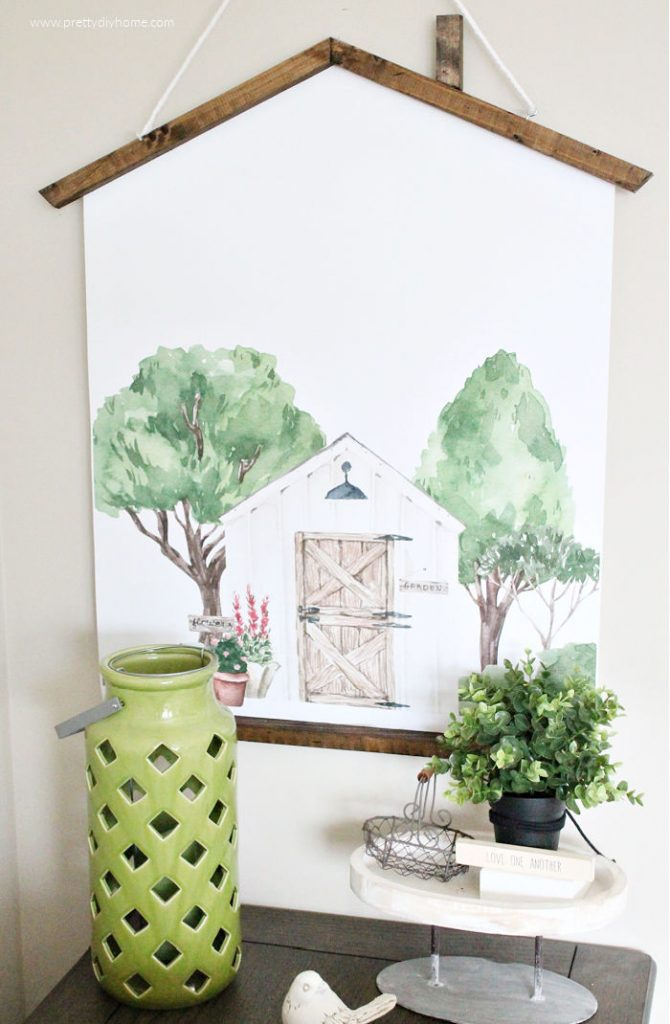 A large DIY farmhouse poster print of a outdoor potting shed surrounded by watercolour painted trees, scrubs and flowers.
