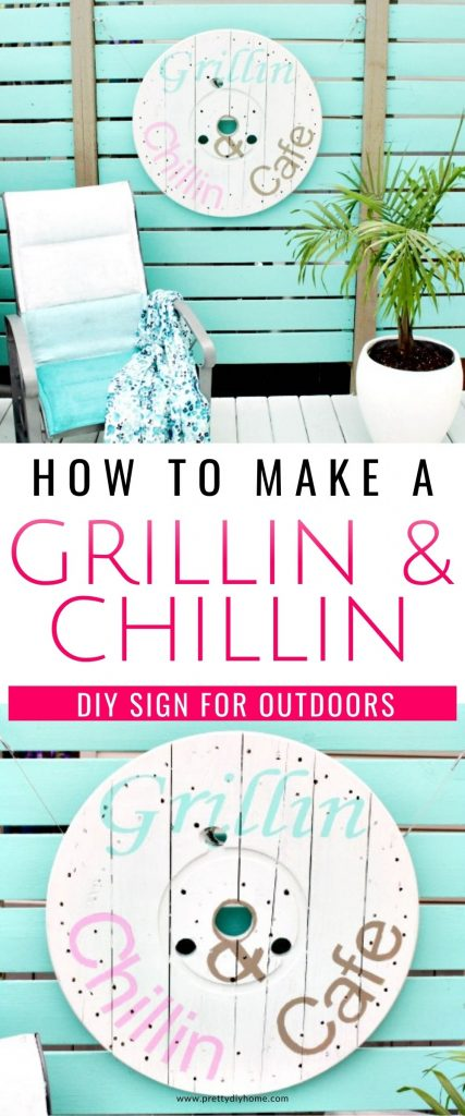 A large DIY Grillin and Chillin sign in turquoise pink and gold lettering. The sign is made out of an old wood spool and it is hanging on a turquoise privacy screen on a back deck.