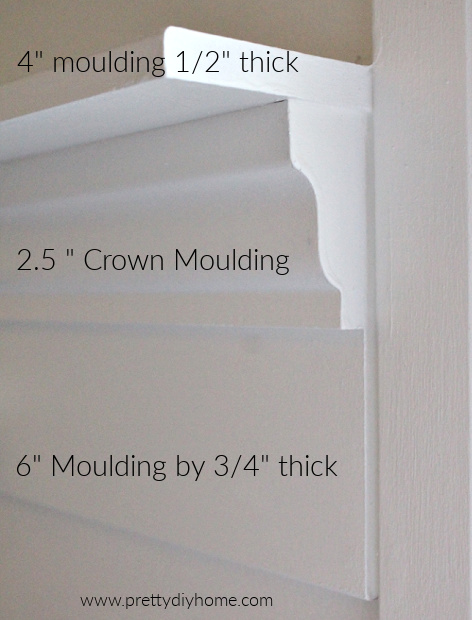 Closeup of edge of DIY wood shelf, showing the three different types of white moulding needed.