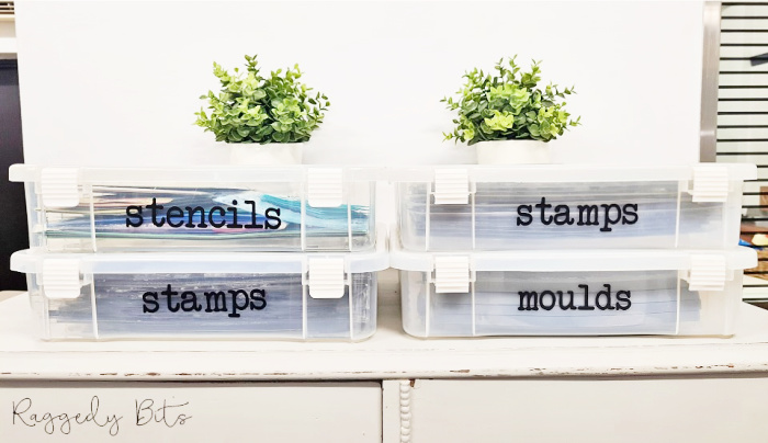 Four 12 by 12 size plastic craft containers with DIY craft labels to organize molds, stencil and supplies.