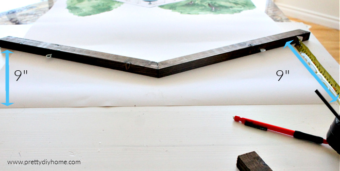 Placing a wooden poster frame on the top of a printed poster.