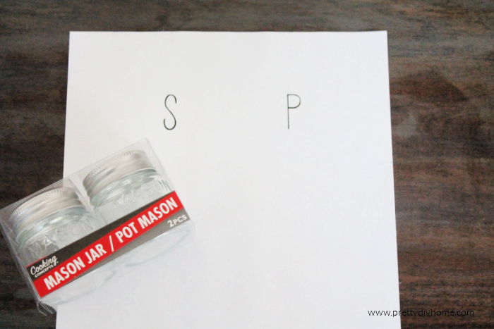 Two dollar tree mini mason jars and a salt and pepper shaker pattern. They are supplies for making dollar store farmhouse salt and pepper shakers using mason jars.