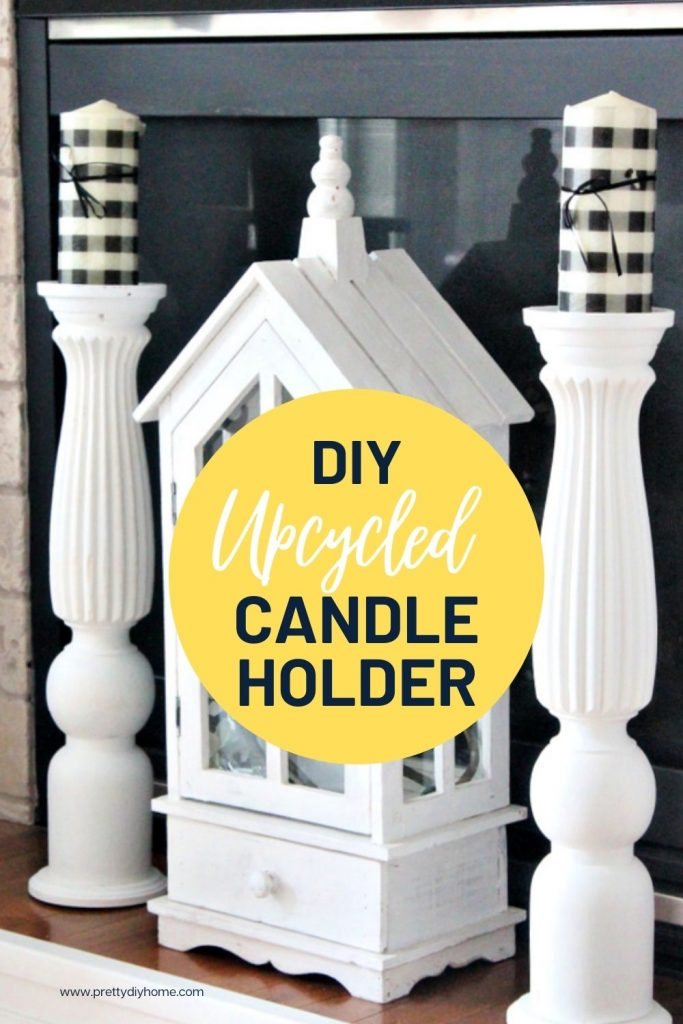 A fireplace mantel with a large white wooden lantern flanked by two farmhouse style large DIY wooden candle sticks.