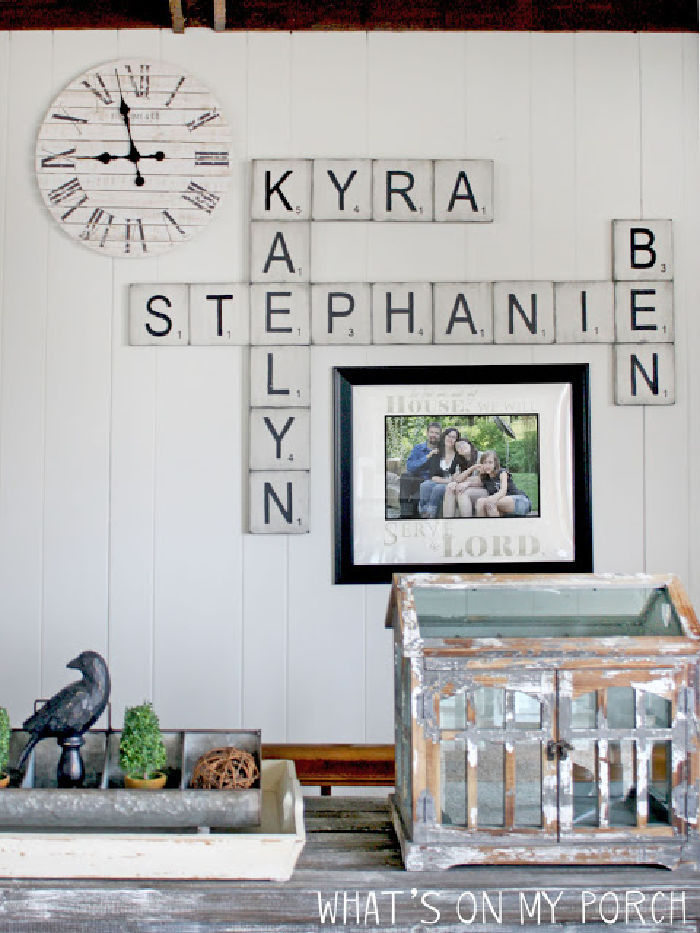 Wall decor made with DIY scrabble pieces, the scrabble letters spell out the families names