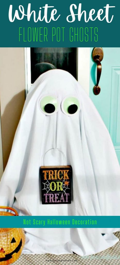 A glum looking fun Hbed sheet Halloween decorations for the front porch, there are two large ghost sentries holding funny Halloween signs. Their faces are long and drawn where the signs are making them look sad being outside on a cold Halloween night.