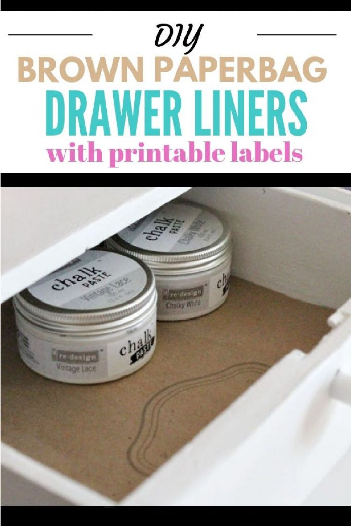 A drawer that is open to show the inside so that you can see a brown paper DIY drawer liner, repurposed from brown bags.