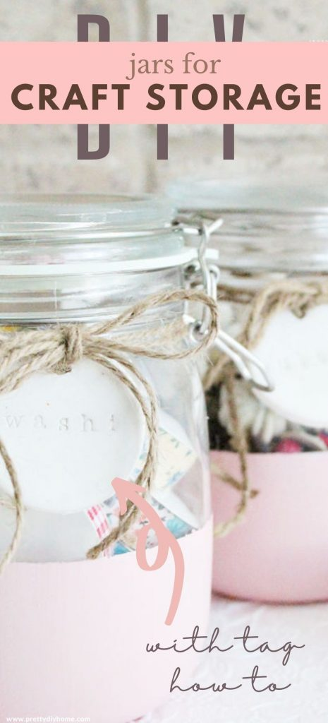 DIY craft storage craft jars for organizing a home office or craft room. These glass jars are painted coral pink and have twine bows for attaching stamped white labels made with clay. The craft storage jars are feminine with soft pastel colours.
