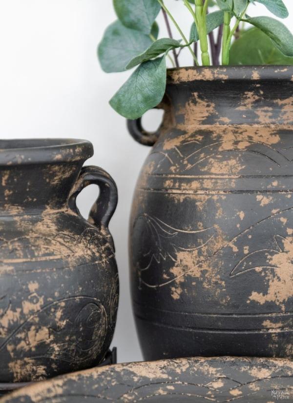Two large mud painted vases in dark brown and beige.