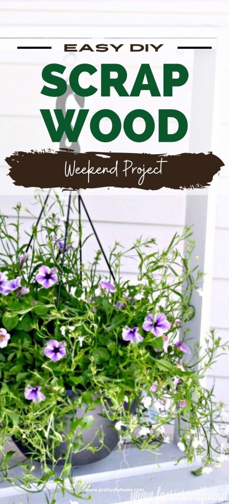 A homemade hanging planter for the front yard, made out of scrap wood. The planter is painted white and has a very large pot of flowers.