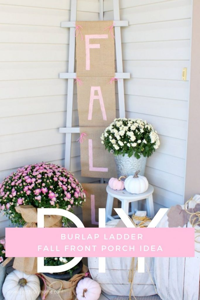 A Fall front porch decorated in pinks, burlap and cream pumpkins, pink and cream Fall flower pots wrapped in burlap. The back ground its a tall farmhouse ladder with a large DIY Fall Banner made with burlap and pink letters.