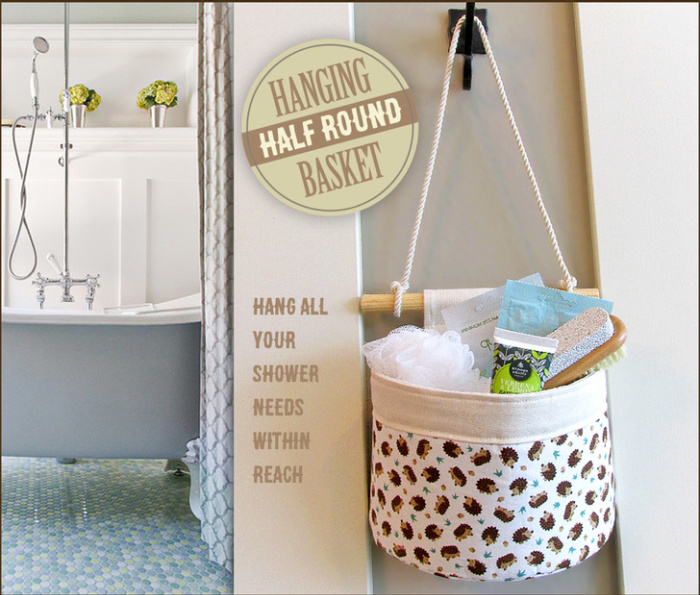 A DIY half round hanging basket, hanging on a wall filled with bath supplies.