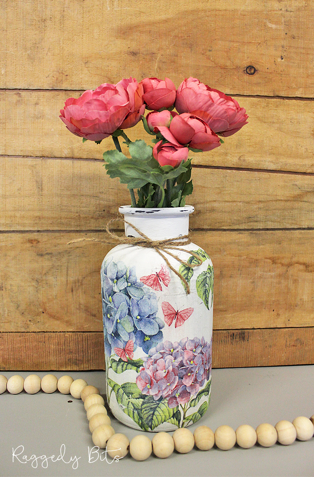 Decoupaged thrift store jar in pretty pastel colours.