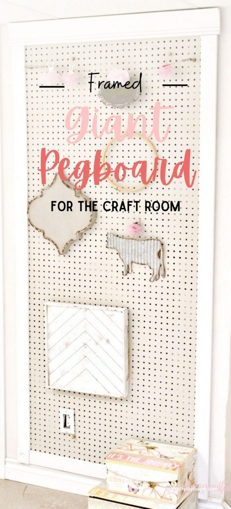 A large cream and white bulletin board for the craft room, This full wall dized diy pegboard display has various hooks and organizers for hanging large craft supplies, like wreath forms.