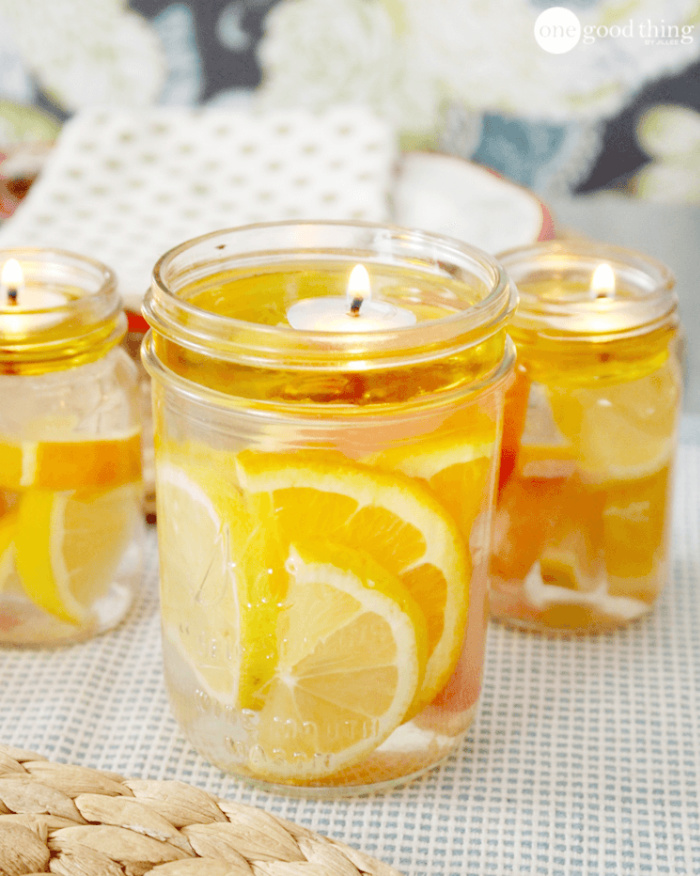 A mason jar floating candle with oranges and lemons.