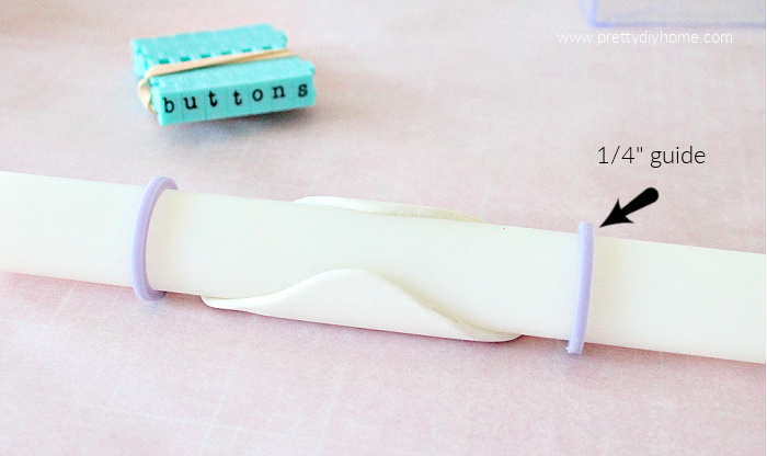Rolling polymer clay to a 1/4 inch thickness using a font rolling pin with 1/4 inch guides.