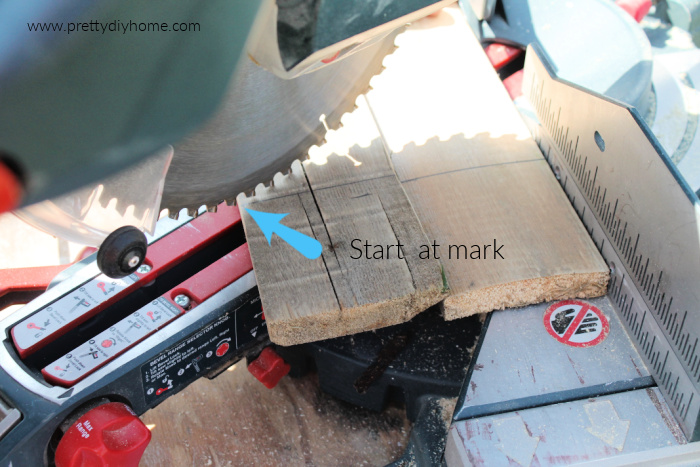 Cutting pallets for a DIY wood pallet Christmas Tree craft idea