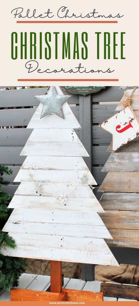 Two DIY pallet wood Christmas tress painted in chippy white paint finish for a rustic farmhouse look. They two wood Christmas trees are outside surrounded by faux trees and a tree farm sign.