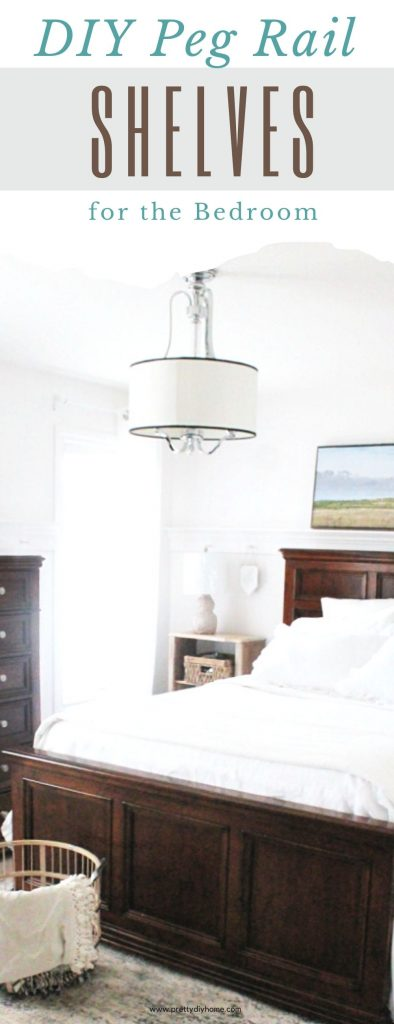 A cottage style bedroom with DIY peg rail shelves. The peg rail shelves are holding pictures over the bed, and over the dresser. There is decor hanging from some of the shelf pegs, and the room has white walls, and white linen bedding.