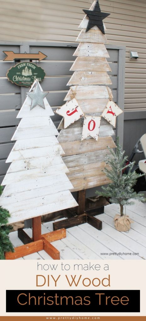 Two farmhouse rustic DIY pallet wood Christmas trees in white and golden brown with Christmas swags and star sitting outdoors for Christmas.