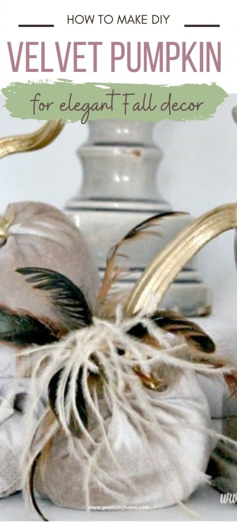Three DIY velvet pumpkins with feathers and gold stems, in a Fall decor arrangement with candles.