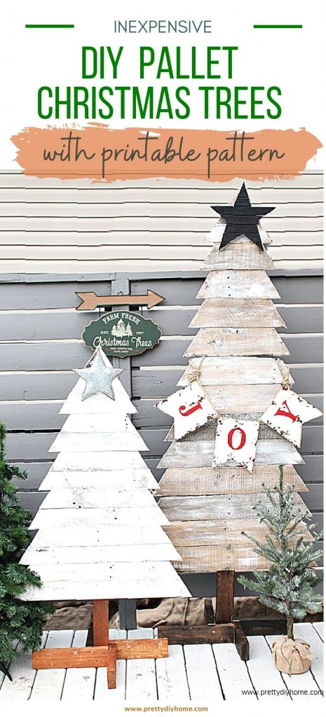 Two pallet Christmas trees that are farmhouse shab with white chippy paint, galvanized stars. They are outside surrounded by small faux Christmas trees and a Christmas tree farm sign.