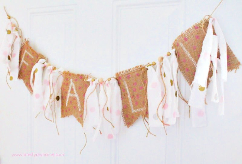 DIY Pink Fall Rag Banner with burlap and pink and gold polka dotted fabric. The banner says Fall, and the burlap has pretty hot pink polka dots. A very girly DIY Fall bunting idea.
