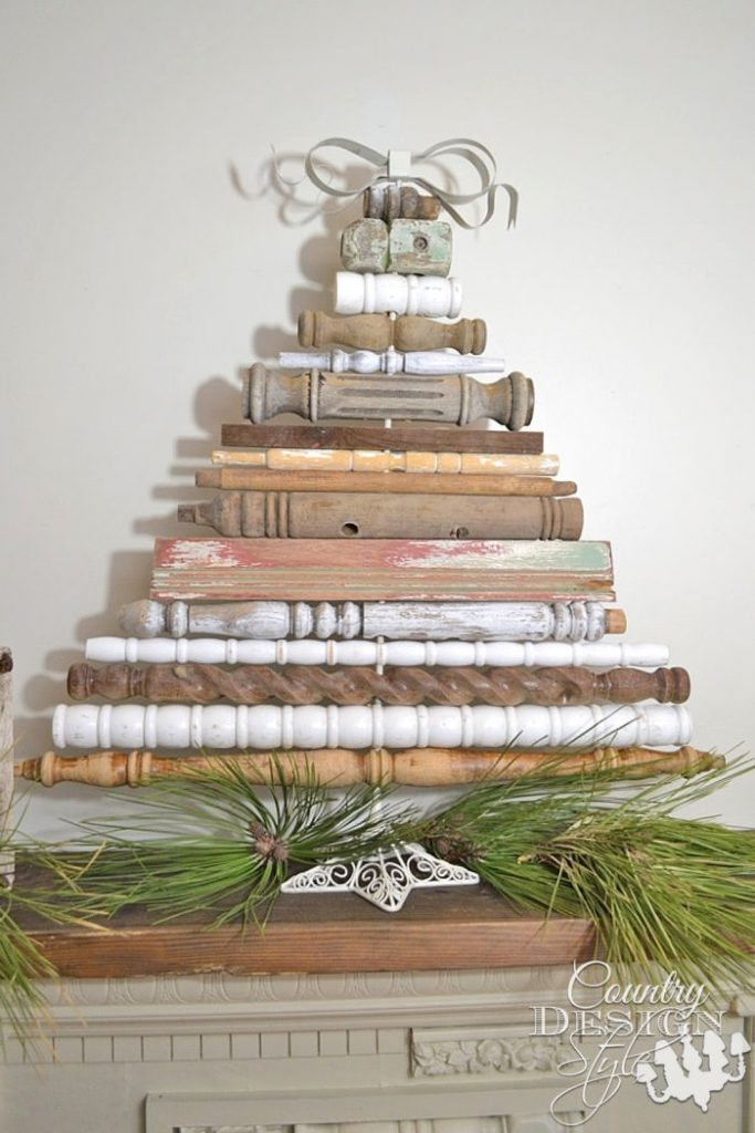 A wooden Christmas tree made out of upcycled wood spindles.