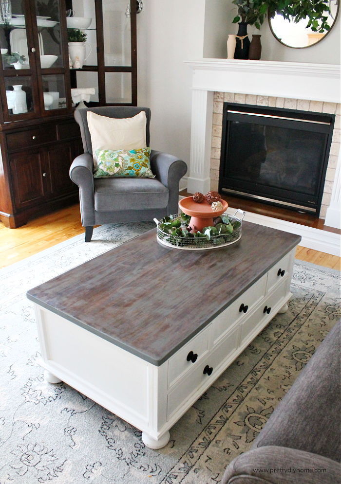 A greige restoration hardware finish on a DIY coffee table makeover. The table top is greige and the sides are bright white.