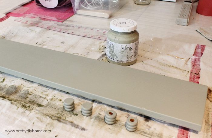 Painting a piece of scrap wood with eucalyptus